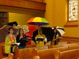 Youth with umbrellas in sanctuary